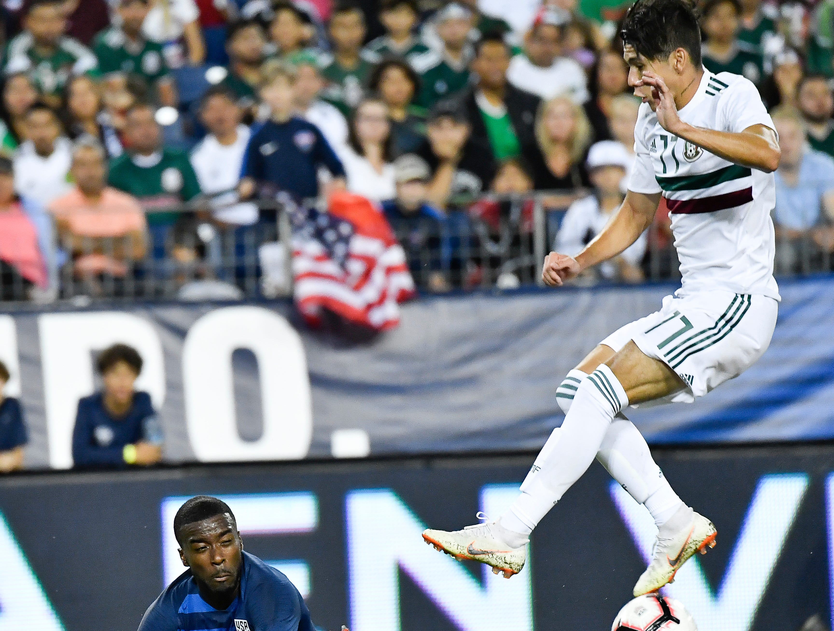 Mexico midfielder Elias Hernandez (11) takes the ball from USA defender Shaq Moore (19) during the second half fo their game at Nissan Stadium Tuesday, Sept. 11, 2018, in Nashville, Tenn.