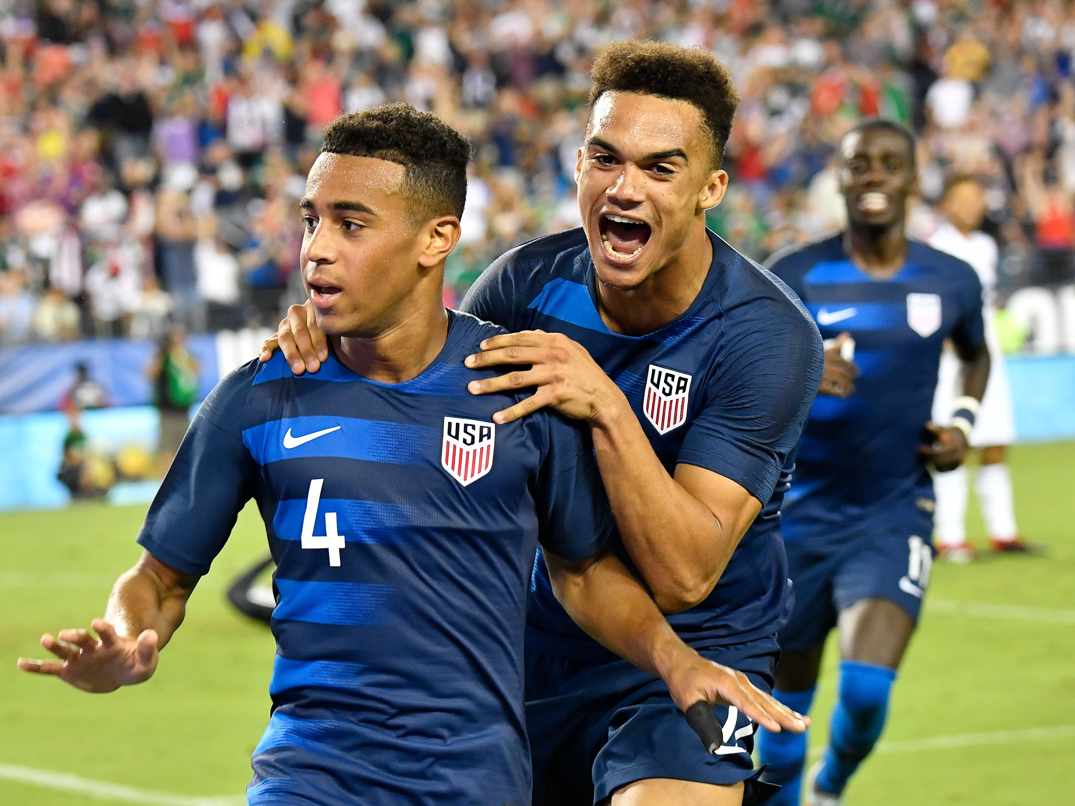USA midfielder Tyler Adams (4) is congratulated after his goal in the second half by defender Antonee Robinson (17) during their match against Mexico at Nissan Stadium Tuesday, Sept. 11, 2018, in Nashville, Tenn.