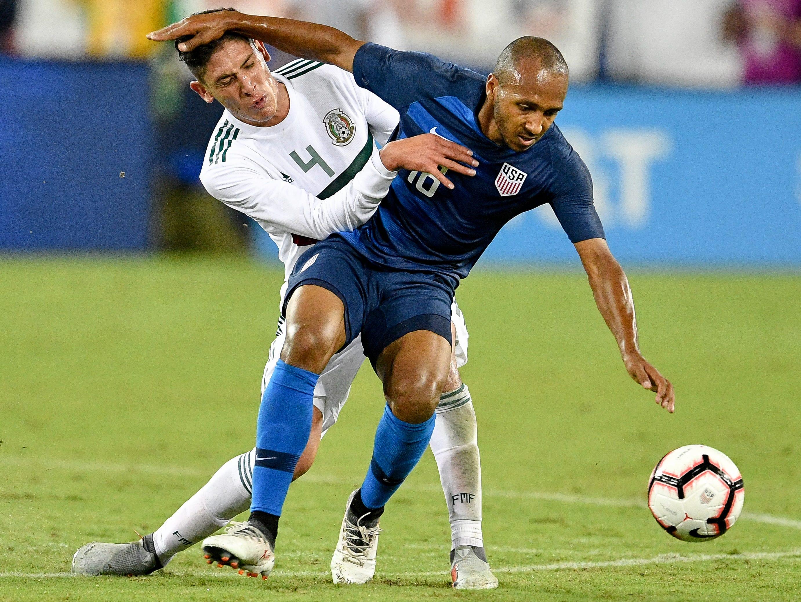 USA midfielder Julian Green (16) battles Mexico defender Edson Alvarez (4) during the second half at Nissan Stadium in Nashville, Tenn., Tuesday, Sept. 11, 2018.