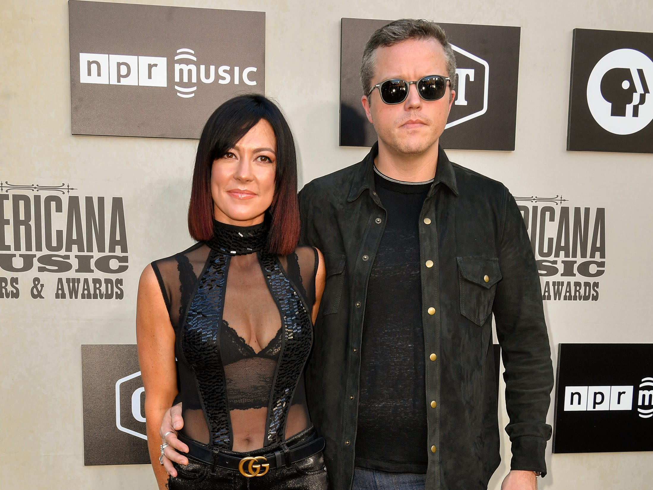 Amanda Shires and Jason Isbell pose on the red carpet before the 2018 Americana Honors and Awards show at the Ryman Auditorium in Nashville, Tenn., Wednesday, Sept. 12, 2018.