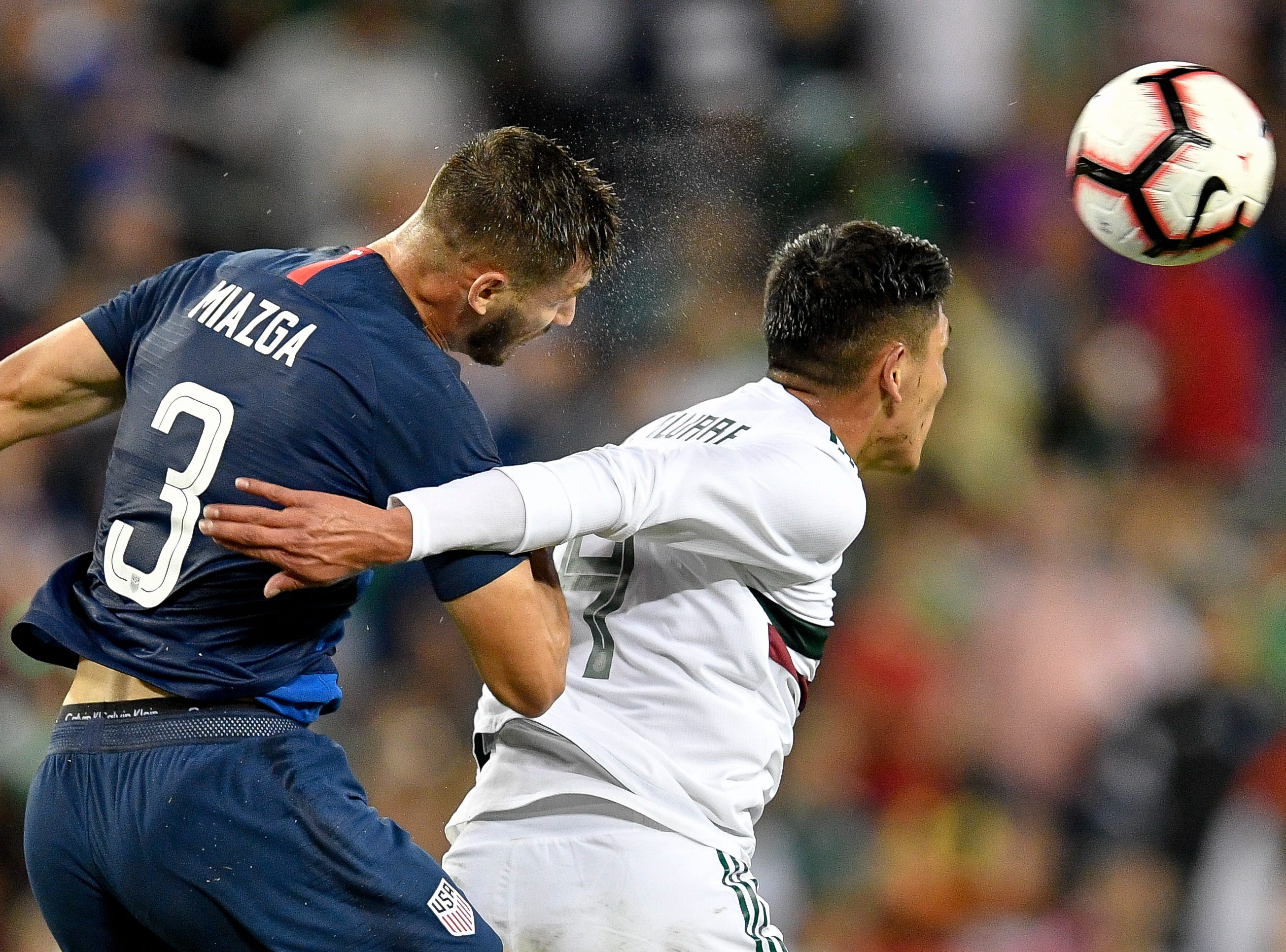 USA defender Matt Miazga (3) goers for a header with Mexico defender Edson Alvarez (4) during the second half at Nissan Stadium in Nashville, Tenn., Tuesday, Sept. 11, 2018.