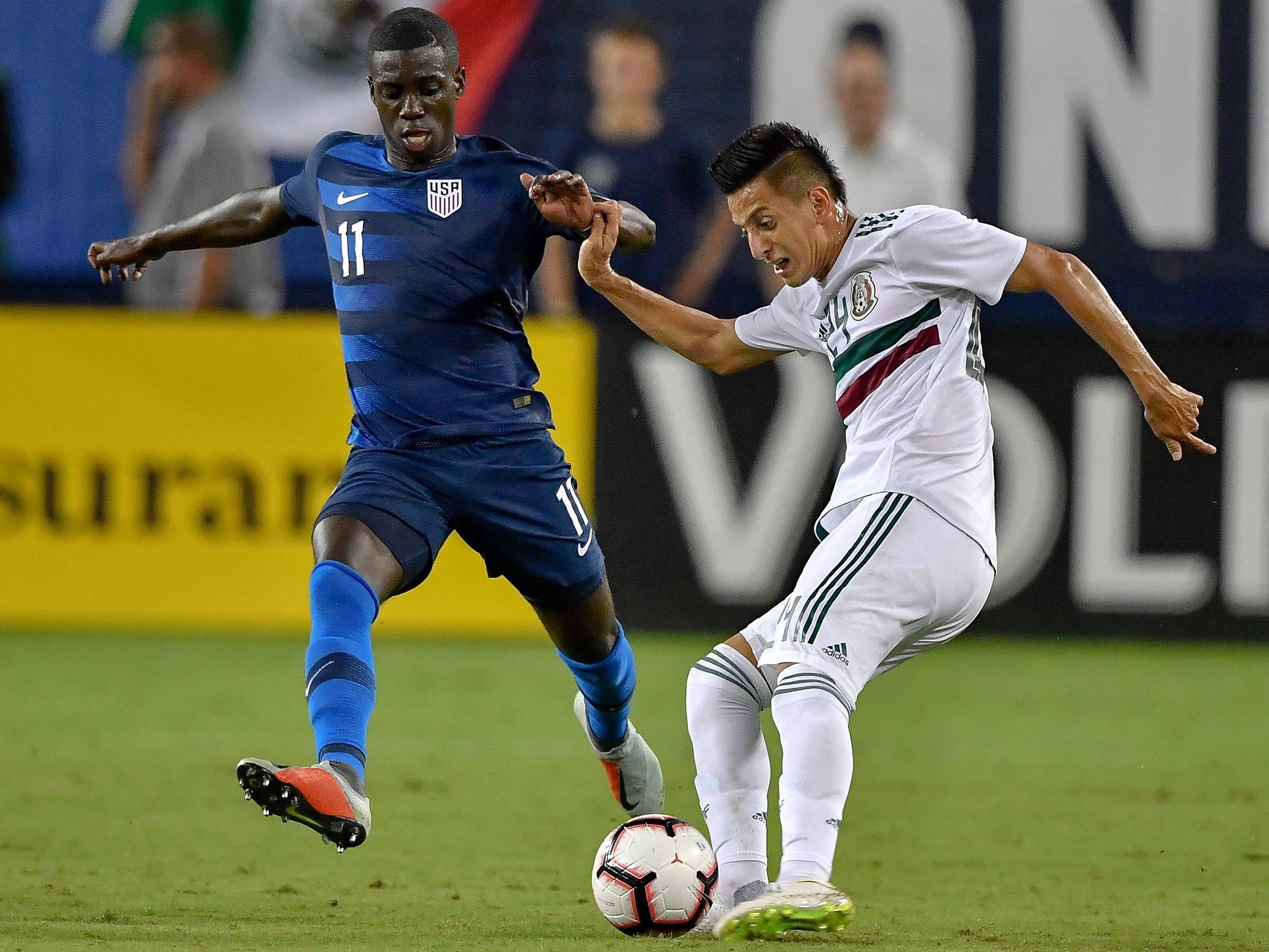Mexico midfielder Roberto Alvarado (24) battles USA midfielder Tim Weah (11) during the first half at Nissan Stadium in Nashville, Tenn., Tuesday, Sept. 11, 2018.