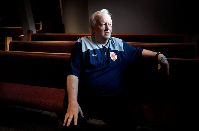 Minister Joey Spann sits inside Burnette Chapel Church of Christ's sanctuary, where renovations are almost complete almost a year after a gunman opened fire on his congregation, killing a church member and injuring seven others, including Spann and his wife.