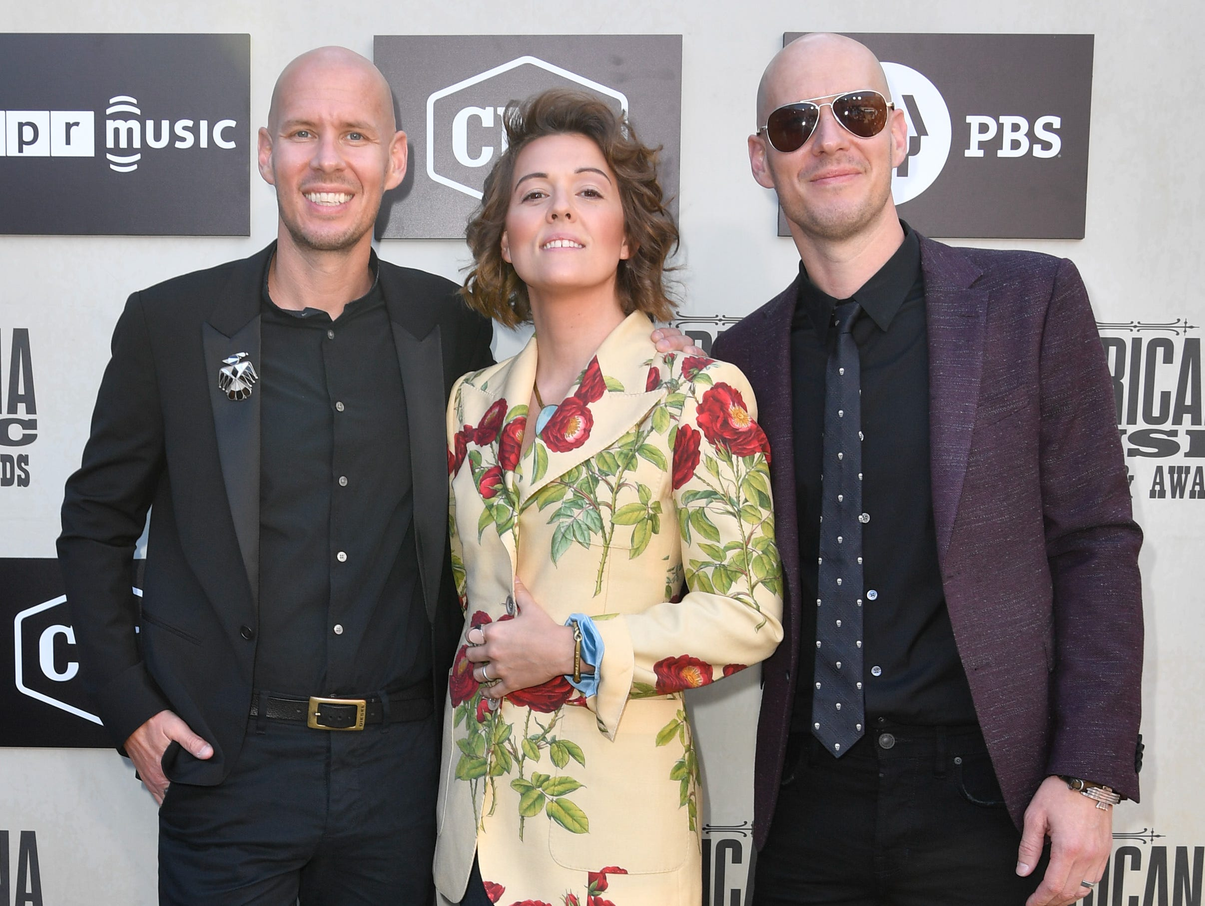 Brandi Carlile, center, poses on the red carpet with Tim Hanseroth and Phil Hanseroth before the 2018 Americana Honors and Awards show at the Ryman Auditorium in Nashville, Tenn., Wednesday, Sept. 12, 2018.