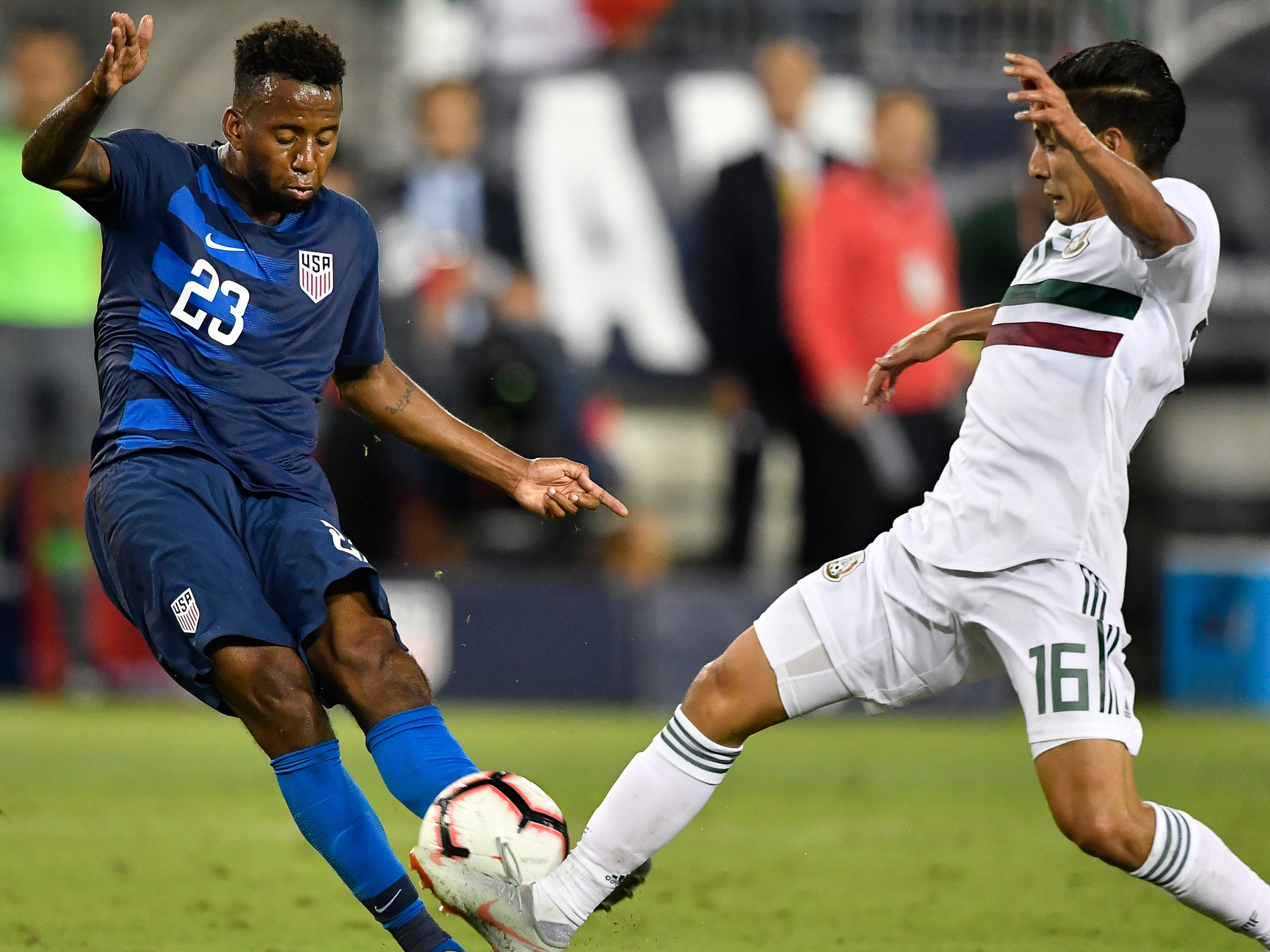 USA midfielder Kellyn Acosta (23) kicks the ball past Mexico midfielder Erick Aguirre (16) during the second half of their game at Nissan Stadium Tuesday, Sept. 11, 2018, in Nashville, Tenn.