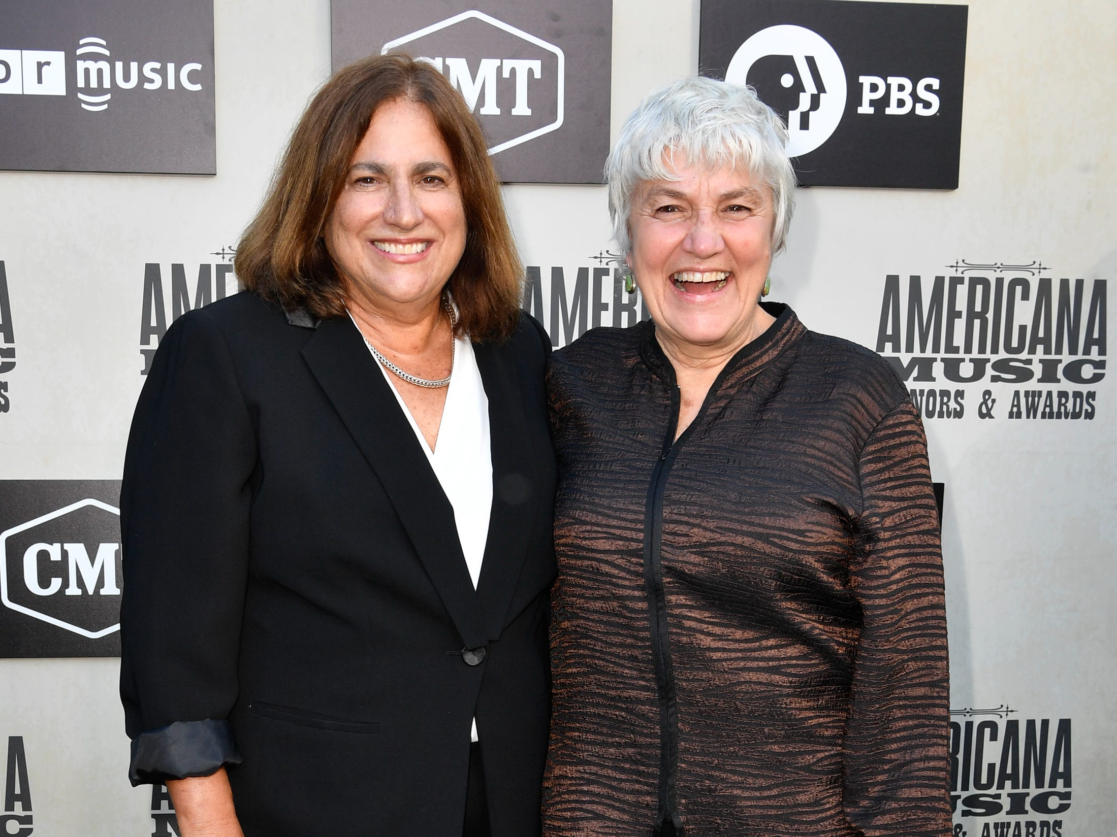 Judy Dlugacz, left, and Cris Williamson, right pose on the red carpet before the 2018 Americana Honors and Awards show at the Ryman Auditorium in Nashville, Tenn., Wednesday, Sept. 12, 2018.