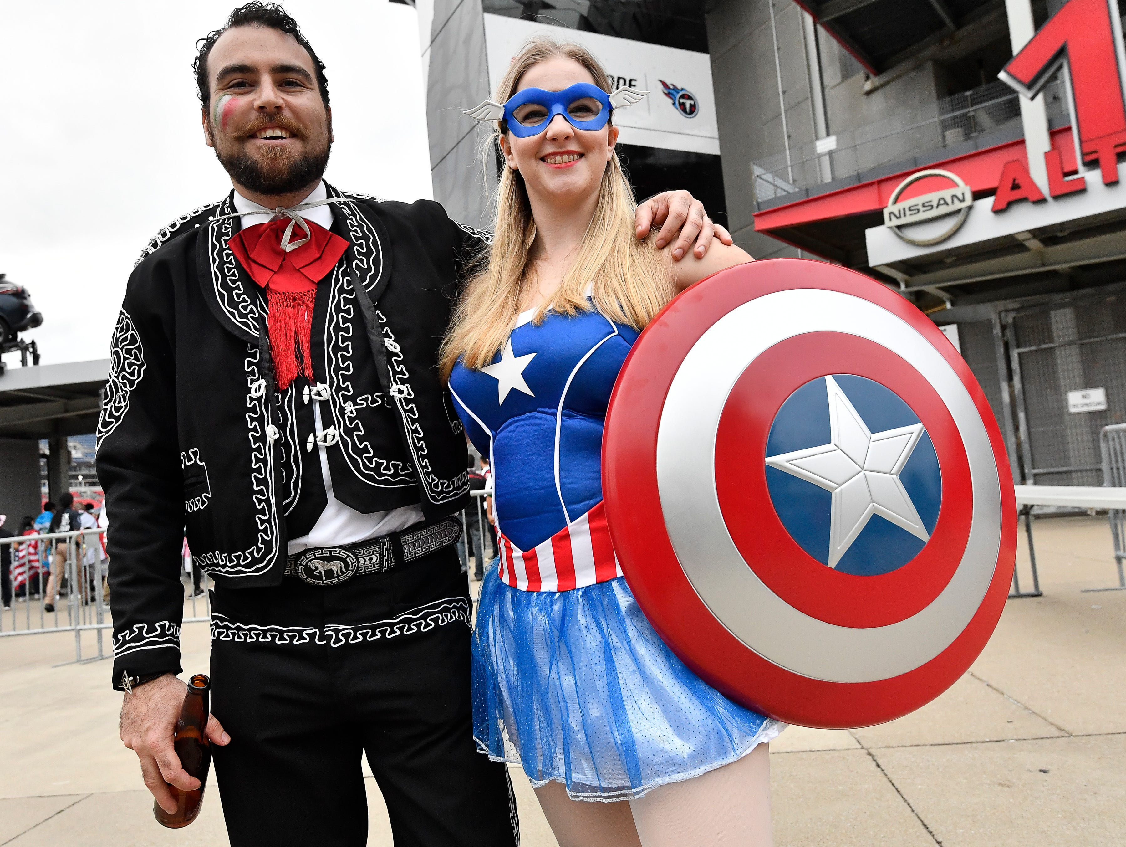 Soccer fans Alfredo Perez and Angela Thomas prepare for the USA vs. Mexico soccer match at Nissan Stadium Tuesday, Sept. 11, 2018, in Nashville, Tenn.