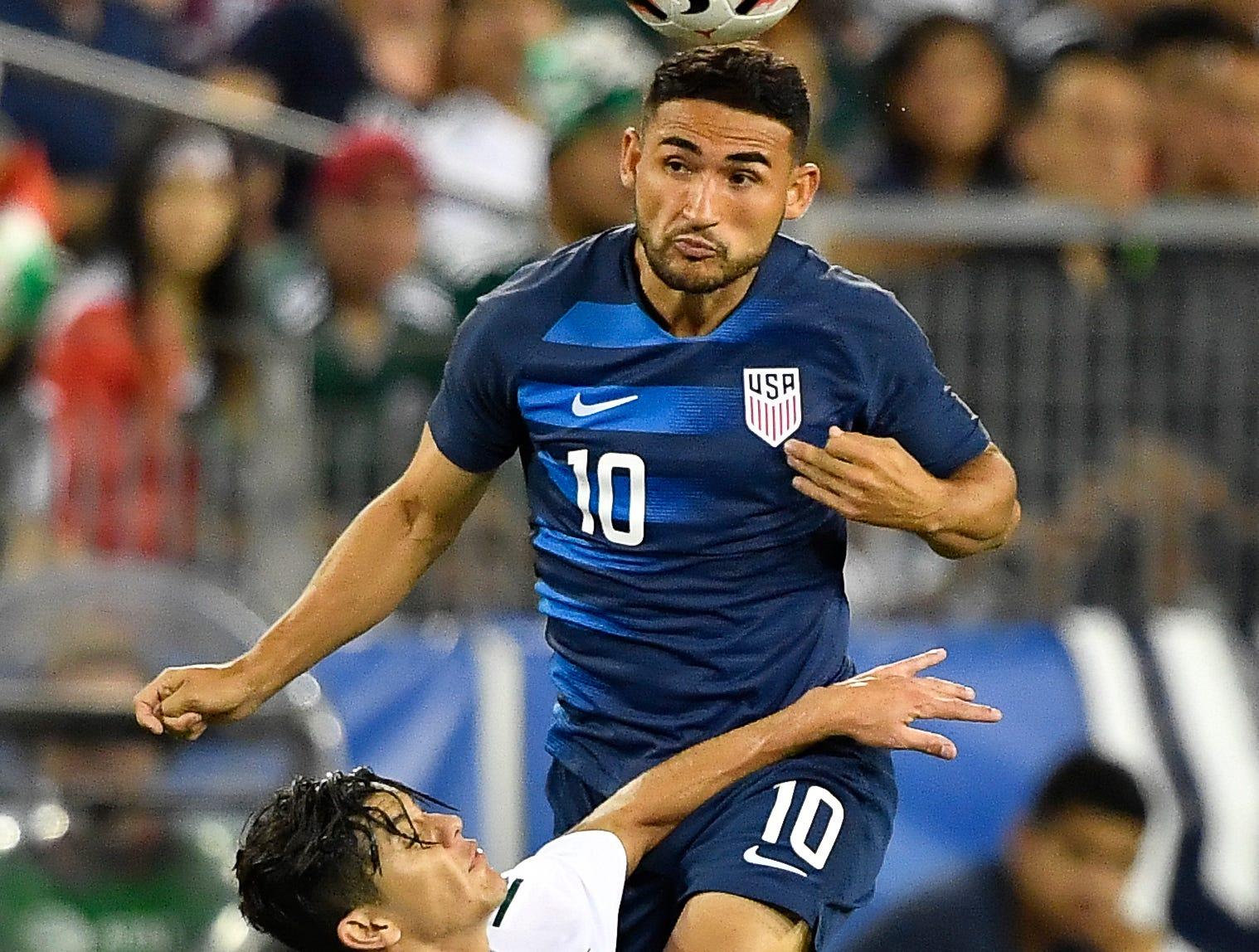 USA midfielder Cristian Roldan (10) heads the ball over Mexico defender Gerardo Arteaga (17) during the second half at Nissan Stadium Tuesday, Sept. 11, 2018, in Nashville, Tenn.