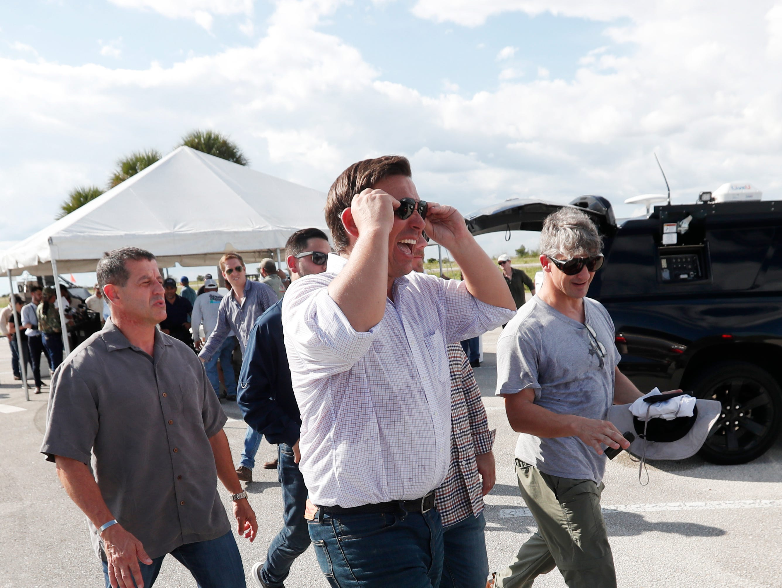 Republican candidate for Florida Governor Ron DeSantis, foreground, heads to his car after an airboat tour of the Florida Everglades, Wednesday, Sept. 12, 2018, in Fort Lauderdale, Fla. (AP Photo/Wilfredo Lee)