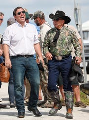 Republican candidate for Florida Governor Ron DeSantis, shares a laugh with Gladesman and former Florida Fish and Wildlife Conservation commissioner Ron Bergeron before an airboat tour of the Florida Everglades, Wednesday, Sept. 12, 2018, in Fort Lauderdale, Fla. (AP Photo/Wilfredo Lee)