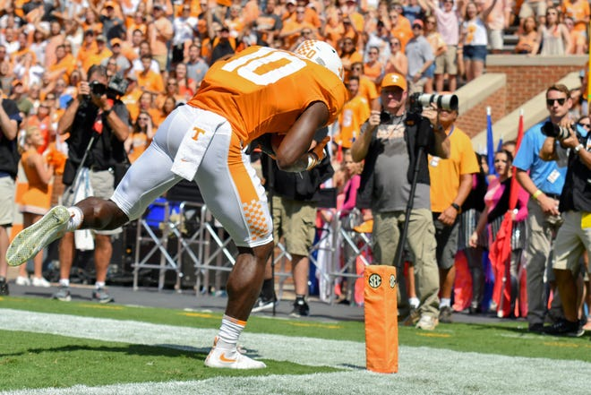 Tennessee Volunteers wide receiver and Naples High School graduate Tyler Byrd (10), shown scoring a touchdown against Massachusetts in a game last year, has switched to defensive back along with former high school teammate and running back Carlin Fils-aime for the Volunteers.