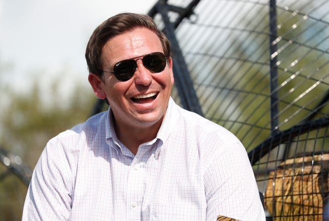 Republican candidate for Florida Governor Ron DeSantis smiles during an airboat tour of the Florida Everglades, Wednesday, Sept. 12, 2018, in Fort Lauderdale, Fla. (AP Photo/Wilfredo Lee)