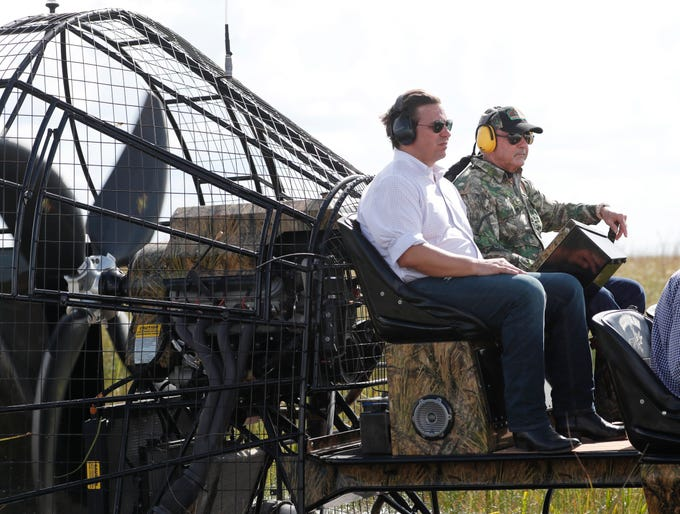 Republican candidate for Florida Governor Ron DeSantis, left, and Gladesman and former Florida Fish and Wildlife Conservation commissioner Ron Bergeron take an airboat tour of the Florida Everglades, Wednesday, Sept. 12, 2018, in Fort Lauderdale, Fla. (AP Photo/Wilfredo Lee)