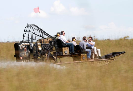 Republican candidate for Florida Governor Ron DeSantis, center, takes an airboat tour of the Florida Everglades, Wednesday, Sept. 12, 2018, in Fort Lauderdale, Fla. (AP Photo/Wilfredo Lee)