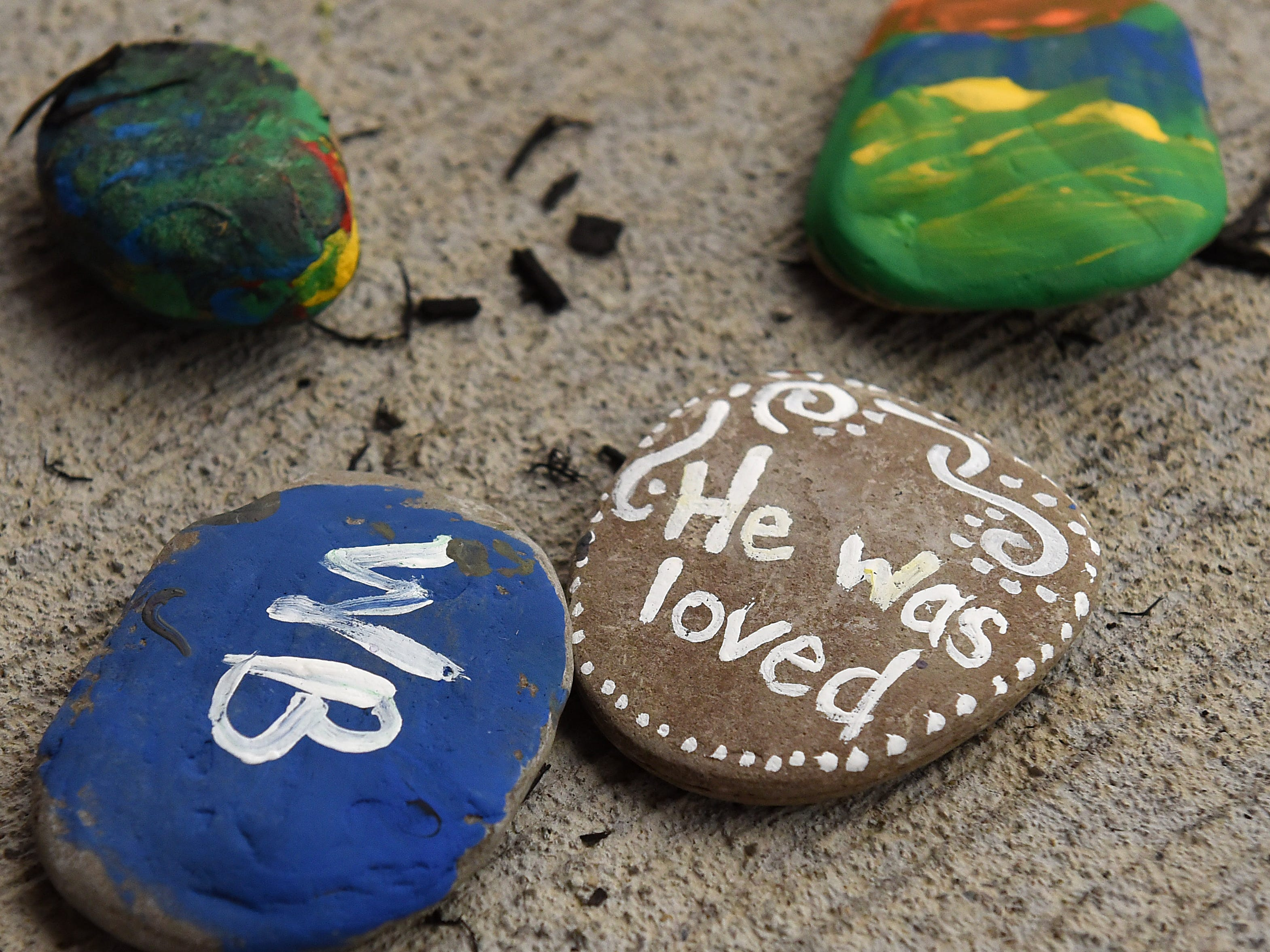 Painted rocks with words of encouragement and remembrance during Mental Health America of Licking County's suicide prevention walk and candlelight vigil on Tuesday, Sept. 11, 2018 at the Canal Market District. The annual event is in recognition of September being Suicide Prevention Awareness month. The event is sponsored by MHA, Licking County Suicide Prevention Coalition, Survivors After Suicide Loss Support Group, and Mental Health & Recovery for Licking and Knox Counties. The Survivors After Suicide Loss Support Group meets at 6:30 p.m. the second Tuesday of every month at Mental Health America of Licking County, 65 Messimer Dr. in Newark.