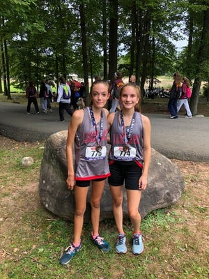 Freshmen Abigail Horevay (L) and Caitlin Fahy are emerging distance runners for the Lakeland girls cross country team this fall. The duo are coming off impressive performances at last week's Season Opener Invitational at Darlington Park.