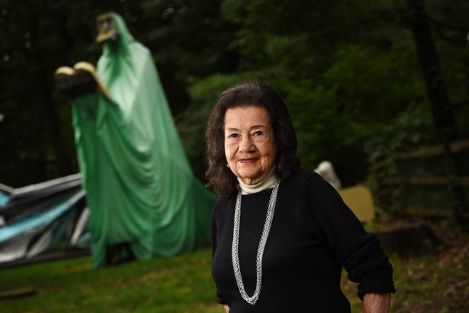Sculptor Judith Peck poses for photos near some of her sculptures at her home in Mahwah on Wednesday September 12, 2018.