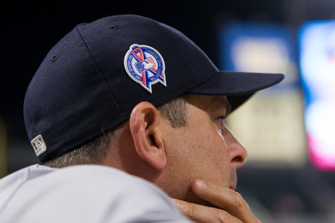 Sep 11, 2018; Minneapolis, MN, USA; New York Yankees manager Aaron Boone wears a hat honoring 9/11 in the fifth inning against Minnesota Twins at Target Field.