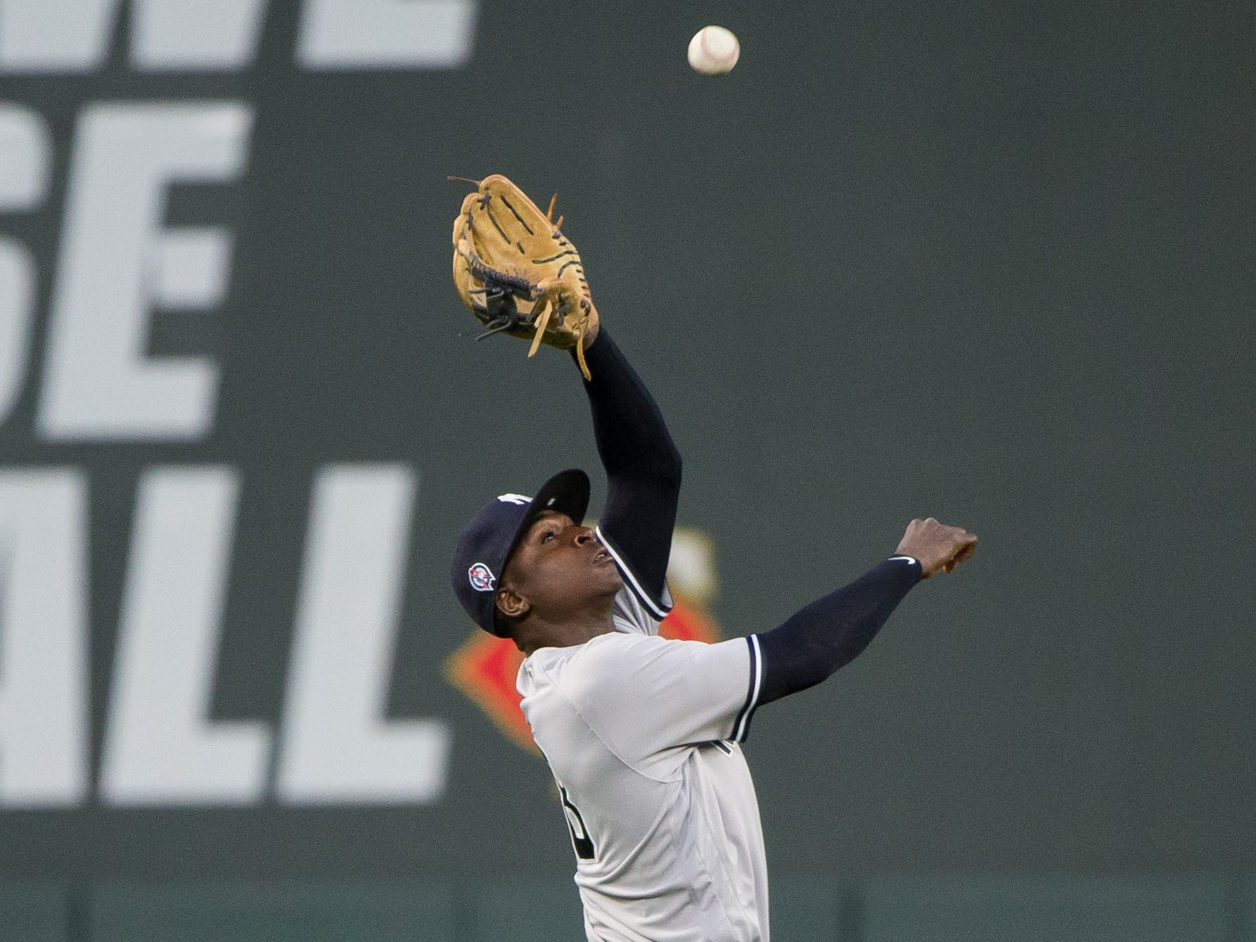 Sep 11, 2018; Minneapolis, MN, USA; New York Yankees shortstop Didi Gregorius (18) fields a fly ball in the first inning against Minnesota Twins at Target Field.