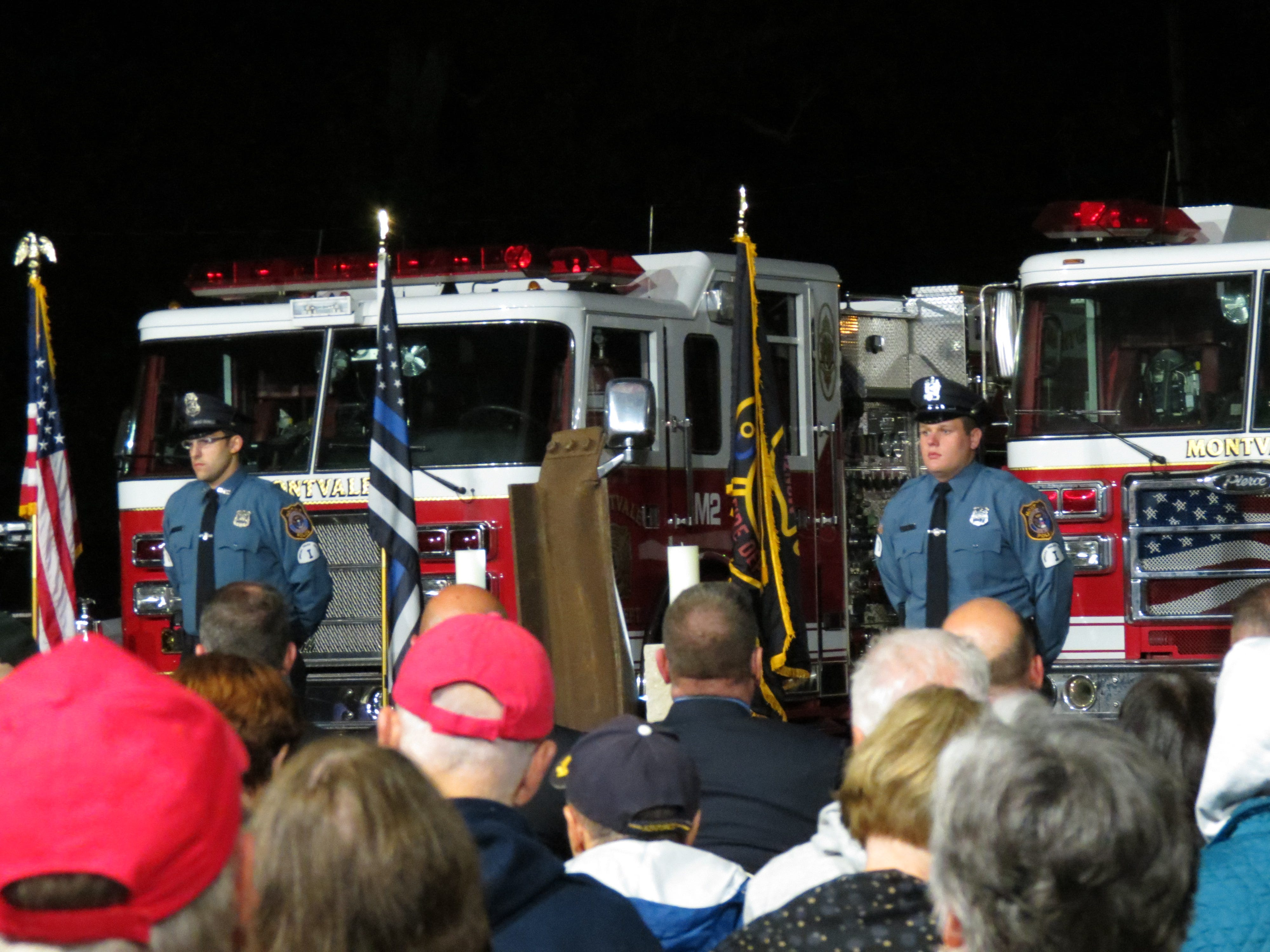 Montvale Police Officers look on as speakers talk during the 9/11 ceremony at the Montvale Fire House on Tuesday, Sept. 18, 2018.