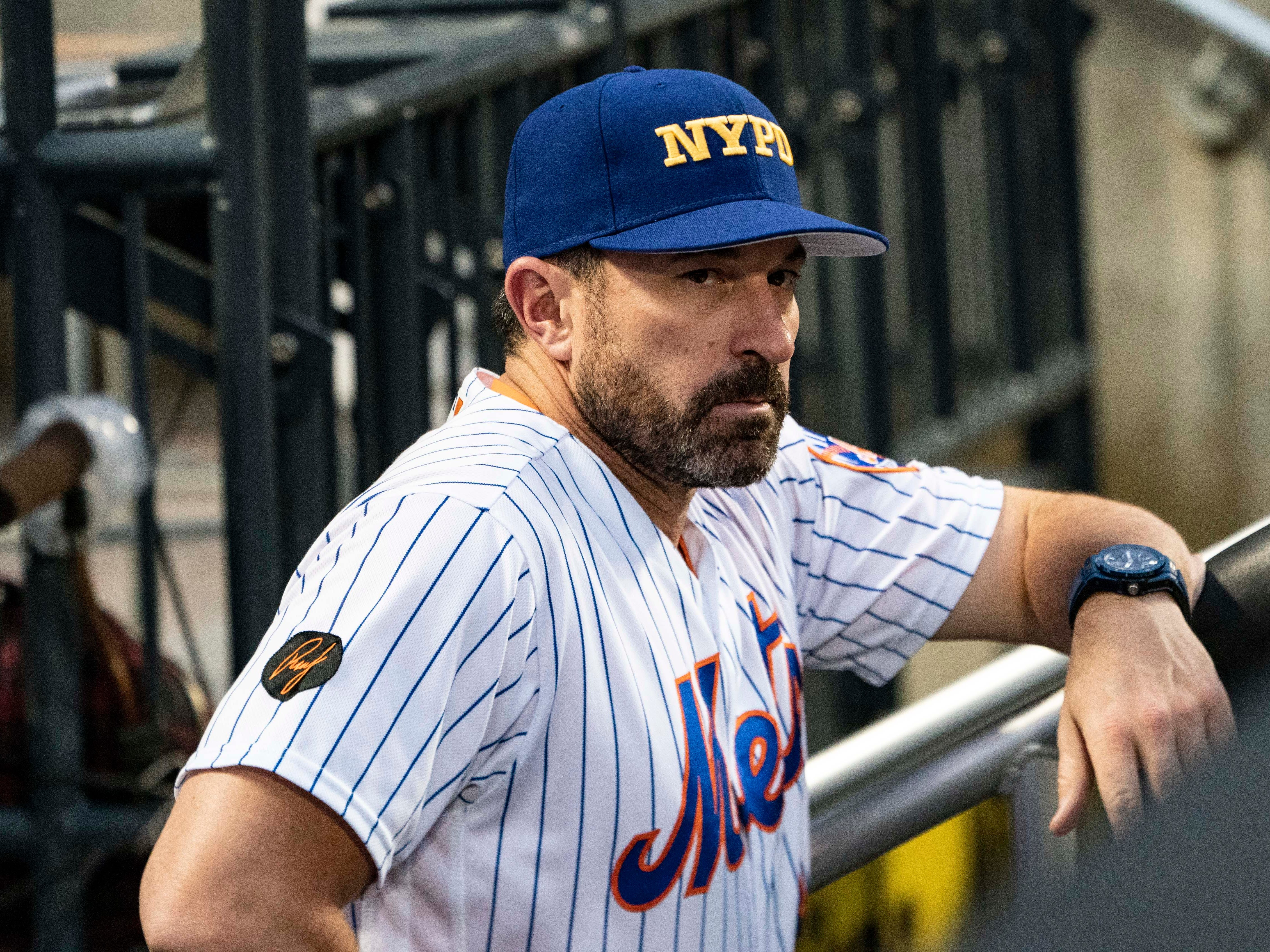 Sep 11, 2018; New York City, NY, USA; New York Mets manager Mickey Callaway (36) wears a NYPD cap to honor  and remember September 11, 2001 during the first inning of the game at Citi Field.