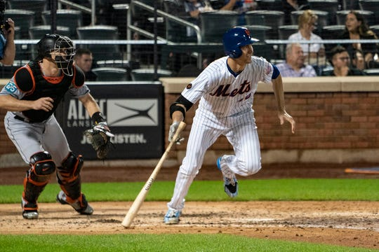 Sep 11, 2018; New York City, NY, USA; New York Mets pitcher Jacob deGrom (48) hits a single during the fifth inning of the game against the Miami Marlins at Citi Field.