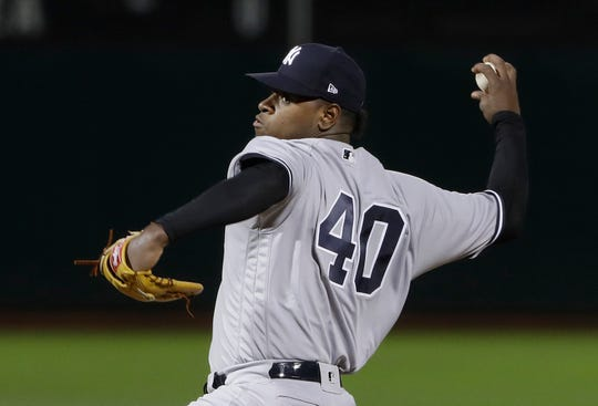 New York Yankees pitcher Luis Severino throws to an Oakland Athletics batter during the first inning of a baseball game in Oakland, Calif., Wednesday, Sept. 5, 2018.