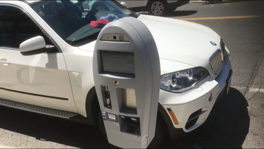 Palisades Park's camera-operated parking meters must comply with a new state law that exempts disabled veterans from paying for metered parking.