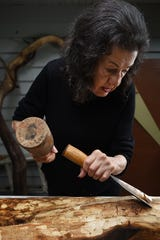 Judith Peck works on a sculpture at her home in Mahwah on Wednesday September 12, 2018.