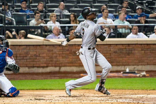 Sep 11, 2018; New York City, NY, USA; Miami Marlins center fielder Lewis Brinson (9) hits an rbi double during the fourth inning of the game against the New York Mets at Citi Field.