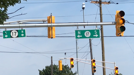 Two identical directional signs show motorists how to reach Route 17 from Polito Avenue in Lyndhurst.