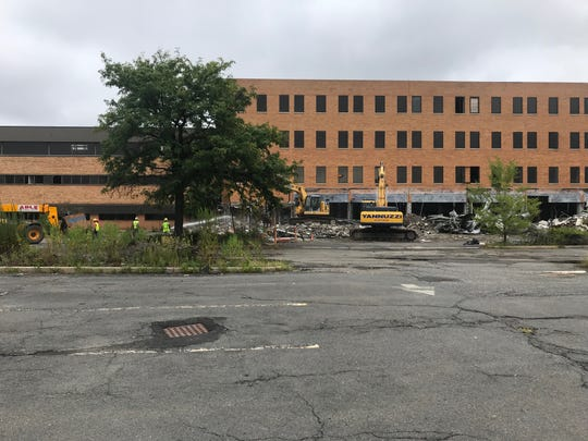 Demolition crews begin to tear down the former headquarters of The Record newspaper, once housed at 150 River St. in Hackensack, on Wed., Sept. 12, 2018.