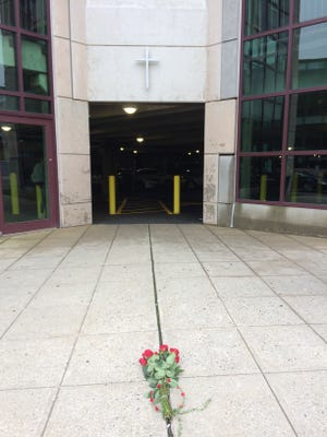 Flowers left at Seton Hall University where a student fell to his death on Tuesday, Sept. 11, 2018.