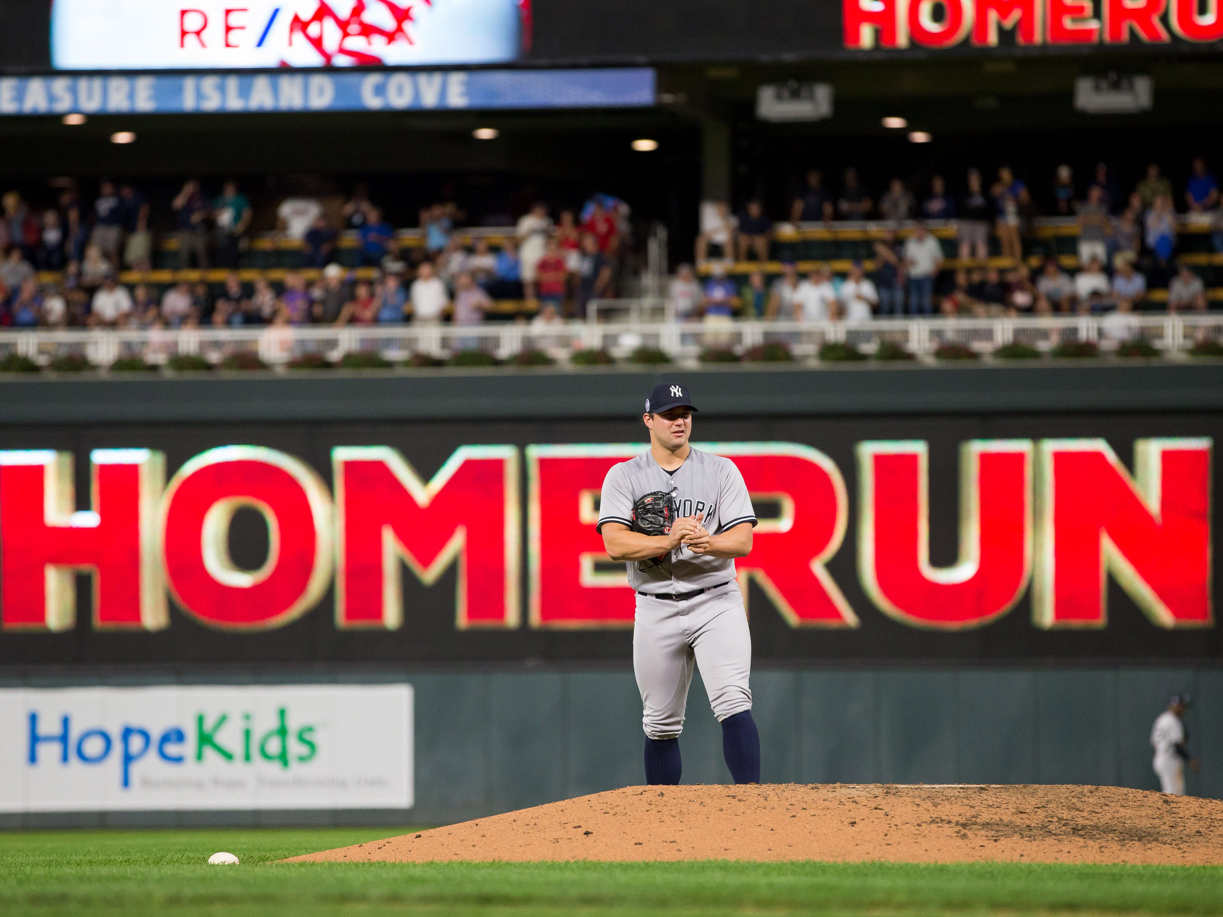 Sep 11, 2018; Minneapolis, MN, USA; New York Yankees relief pitcher Tommy Kahnle (48) gives up a grand slam home run in the fifth inning against Minnesota Twins first baseman Joe Mauer (7) at Target Field.