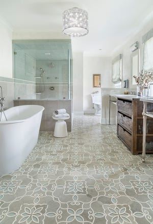 This Upper Saddle River bathroom centers around two elements – a Granada Smoke tile pattern from Artistic Tile and a freestanding bathtub.