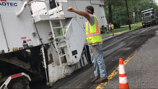 Full-scale, curb-to-curb asphalt-paving is much smoother, but much more expensive, than filling individual potholes.