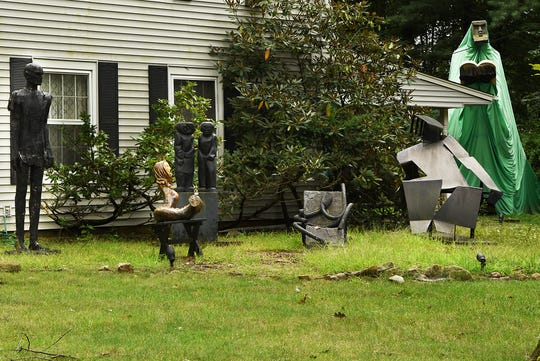 Sculptures by Judith Peck, including 'Moses' (right), displayed on the lawn of her home in Mahwah on Wednesday September 12, 2018.