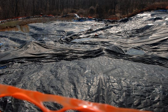 Plastic over the pit at the Peters Mine site.  Robert Kennedy, Jr. along with Senator Frank Lautenberg and Congressman Frank Pallone  visiting the Peters Mine and Canon Mine superfund cleanup sites in Ringwood Monday.