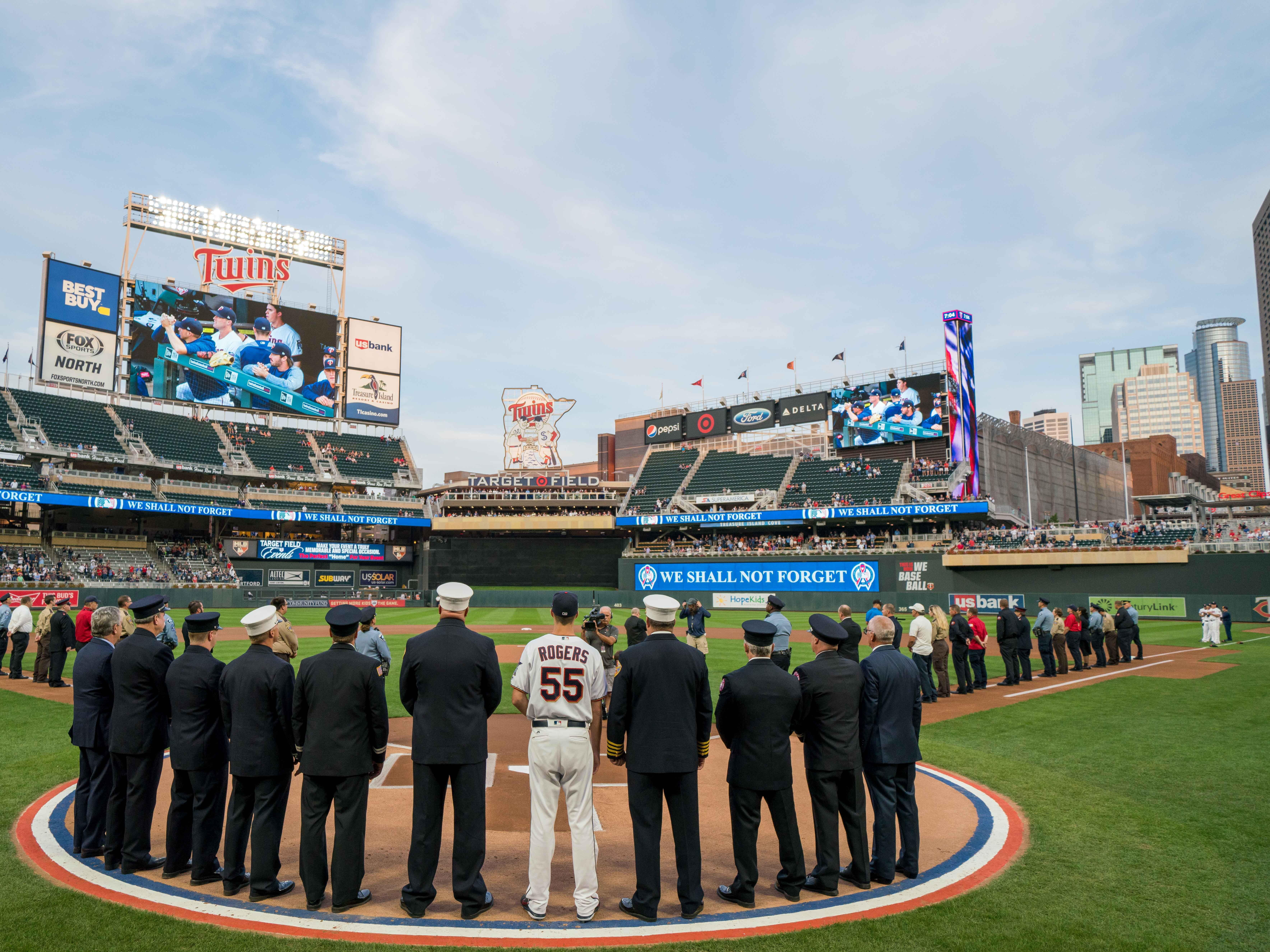 Sep 11, 2018; Minneapolis, MN, USA; Minnesota Twins relief pitcher Taylor Rogers (55) joins first responders in a 9/11 tribute before the game against the New York Yankees at Target Field.