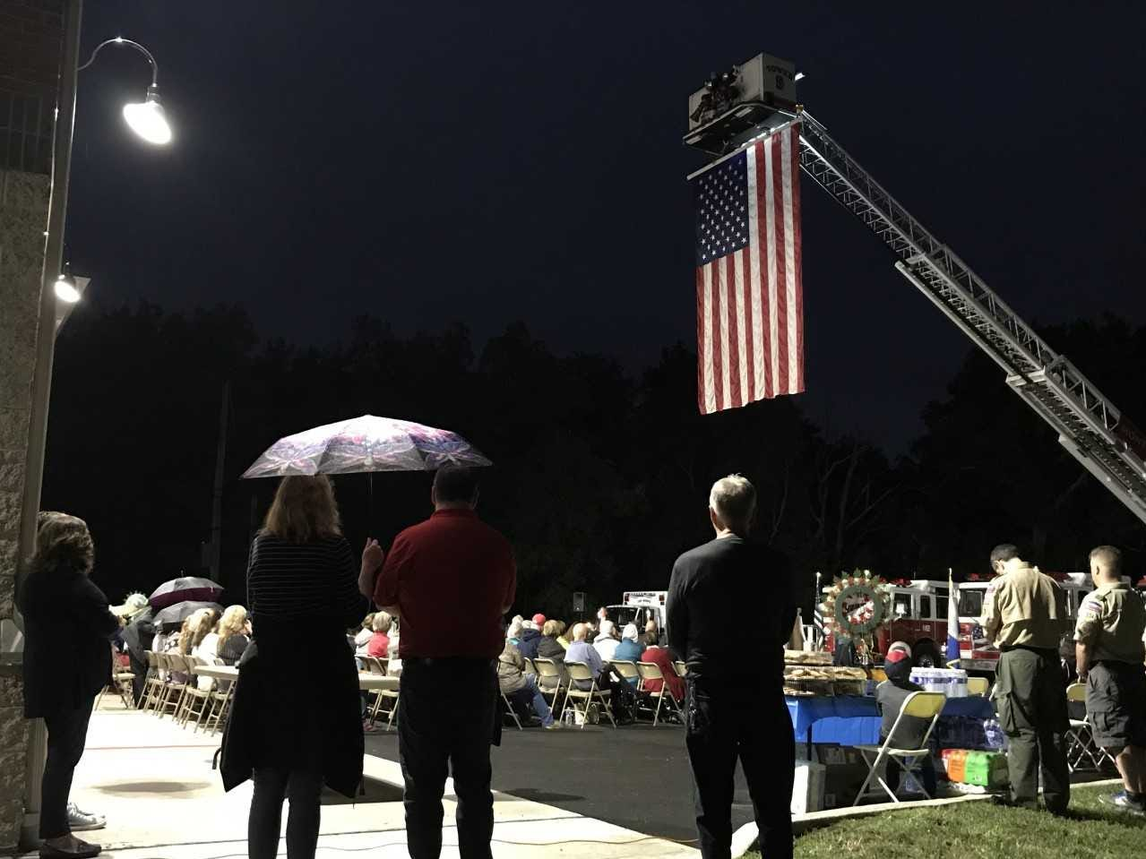 People watch as an FBI special agent, state politicians, and a 9/11 first responder, among others speak during a 9/11 ceremony at the Montvale Fire House on Sept. 11, 2018.