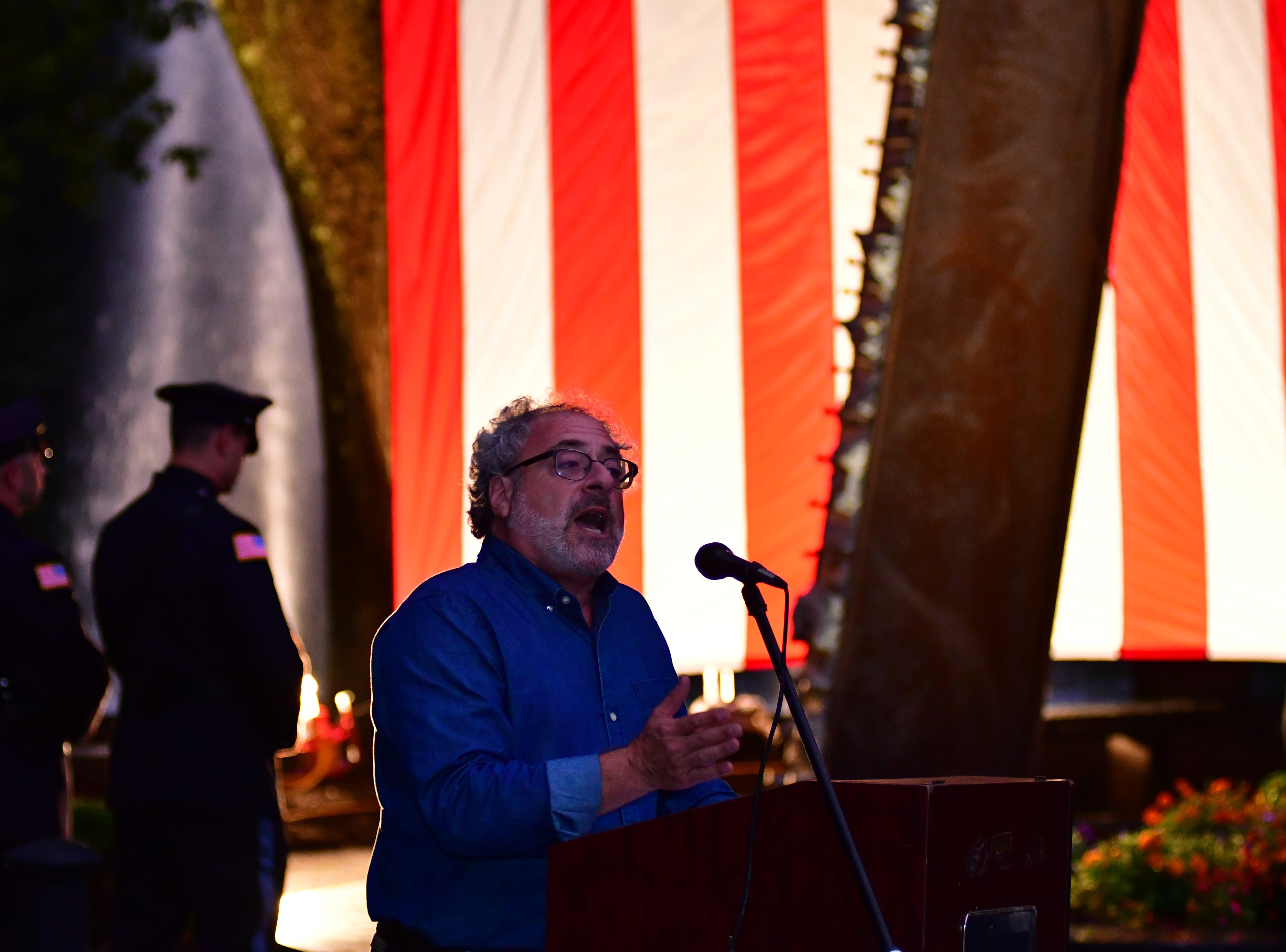 David Handschuh, speaks about his experience as a photographer covering the World Trade Center terrorist attack in New York in 2001. After taking photos that were published in the newspapers David sustained injuries (broken legs) and had to be rescued.  Event was at the Crestwood Lake Memorial in Allendale on Tuesday September 11, 2018.