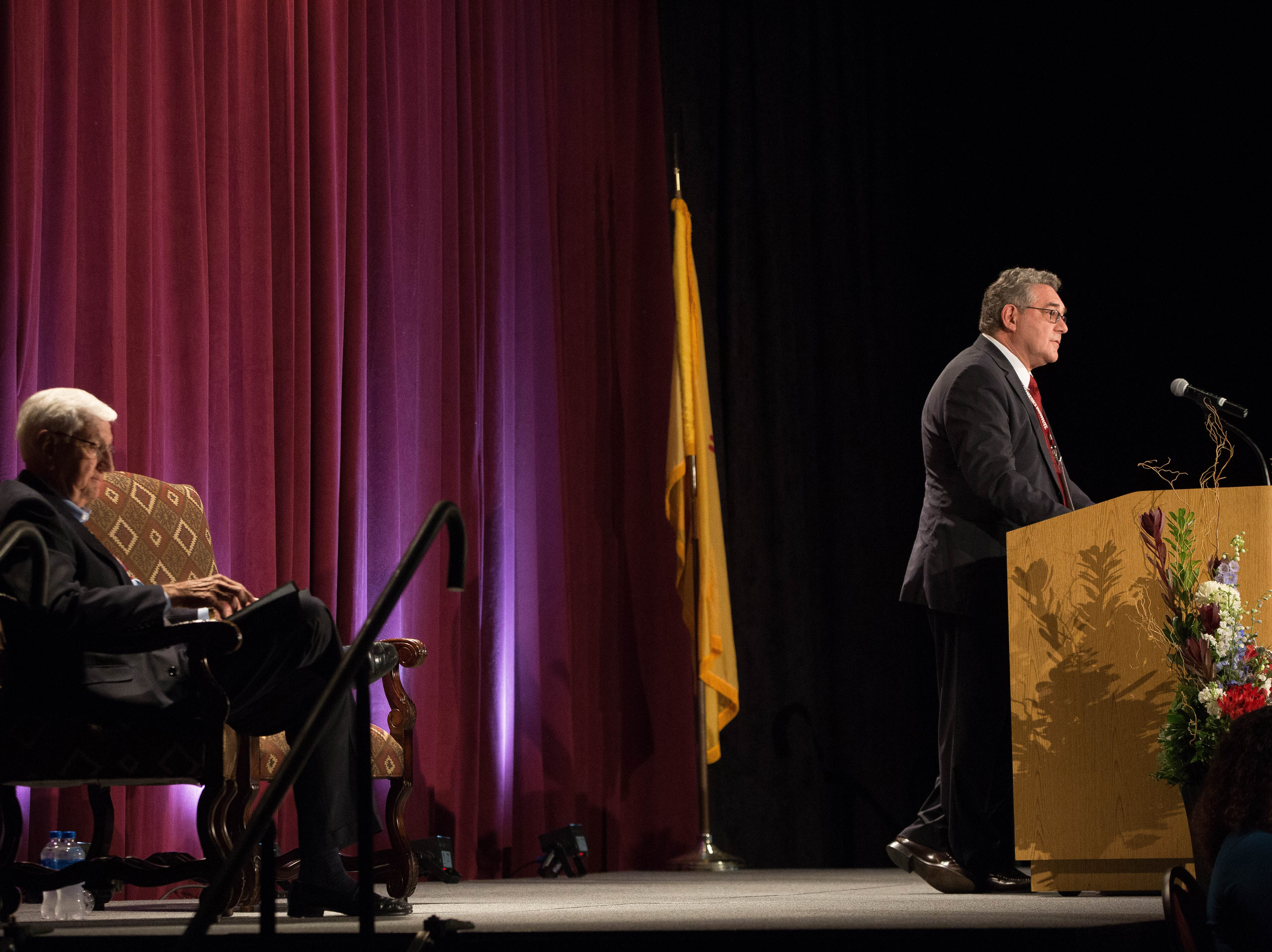 John Floros, right, president of New Mexico State University, speaks to the attendees of the 2018 Domenici Public Policy Conference at the Las Cruces Convention Center, Wednesday, Sept. 12, 2018.