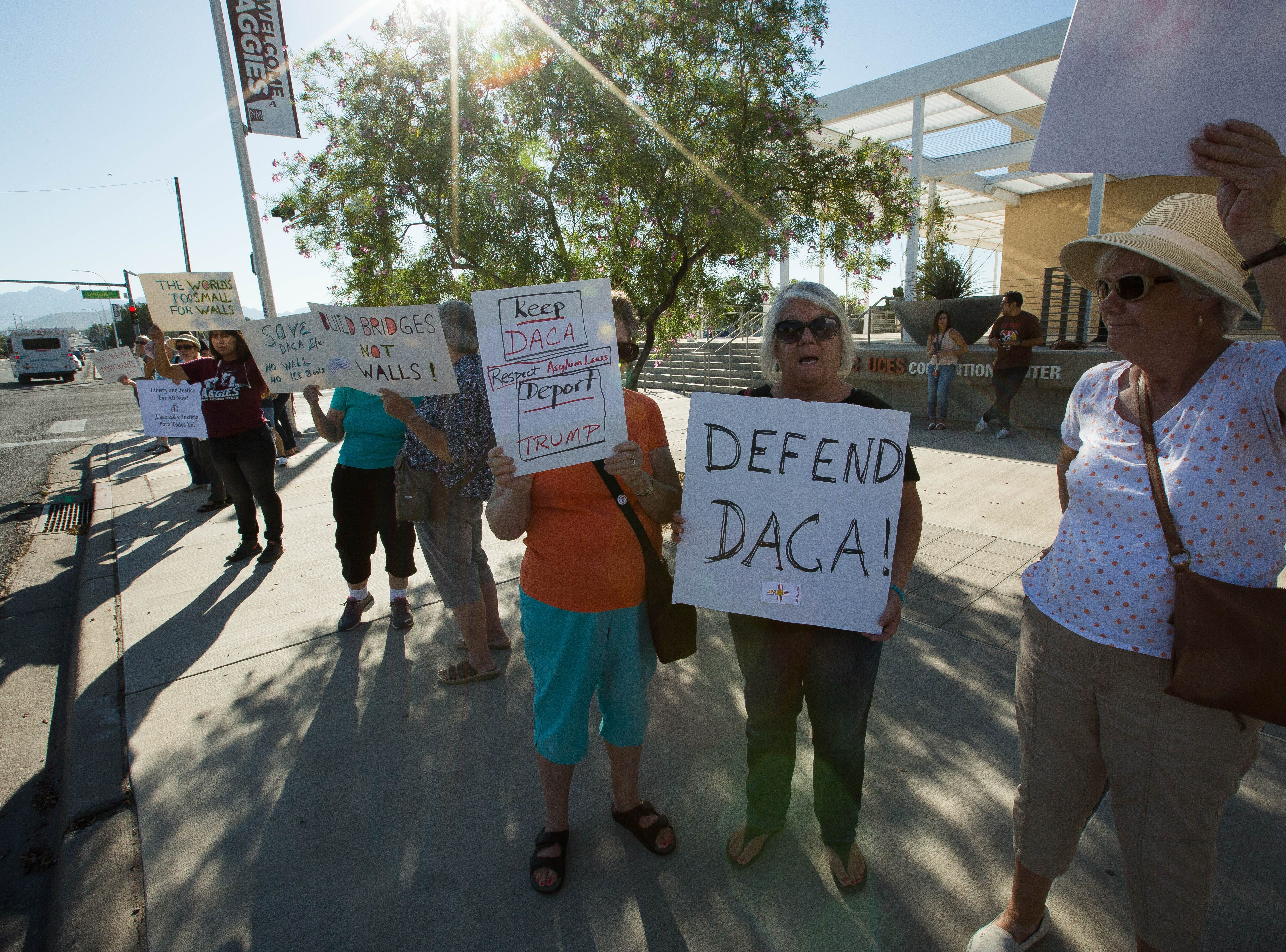 Demonstrators gather outside the Las Cruces Convention Center, during the start of the 2018 Domenici Public Policy Conference , Wednesday, Sept. 12, 2018. The group of demonstrators were from NM CAFé and the Las Cruces chapter of Indivisible.