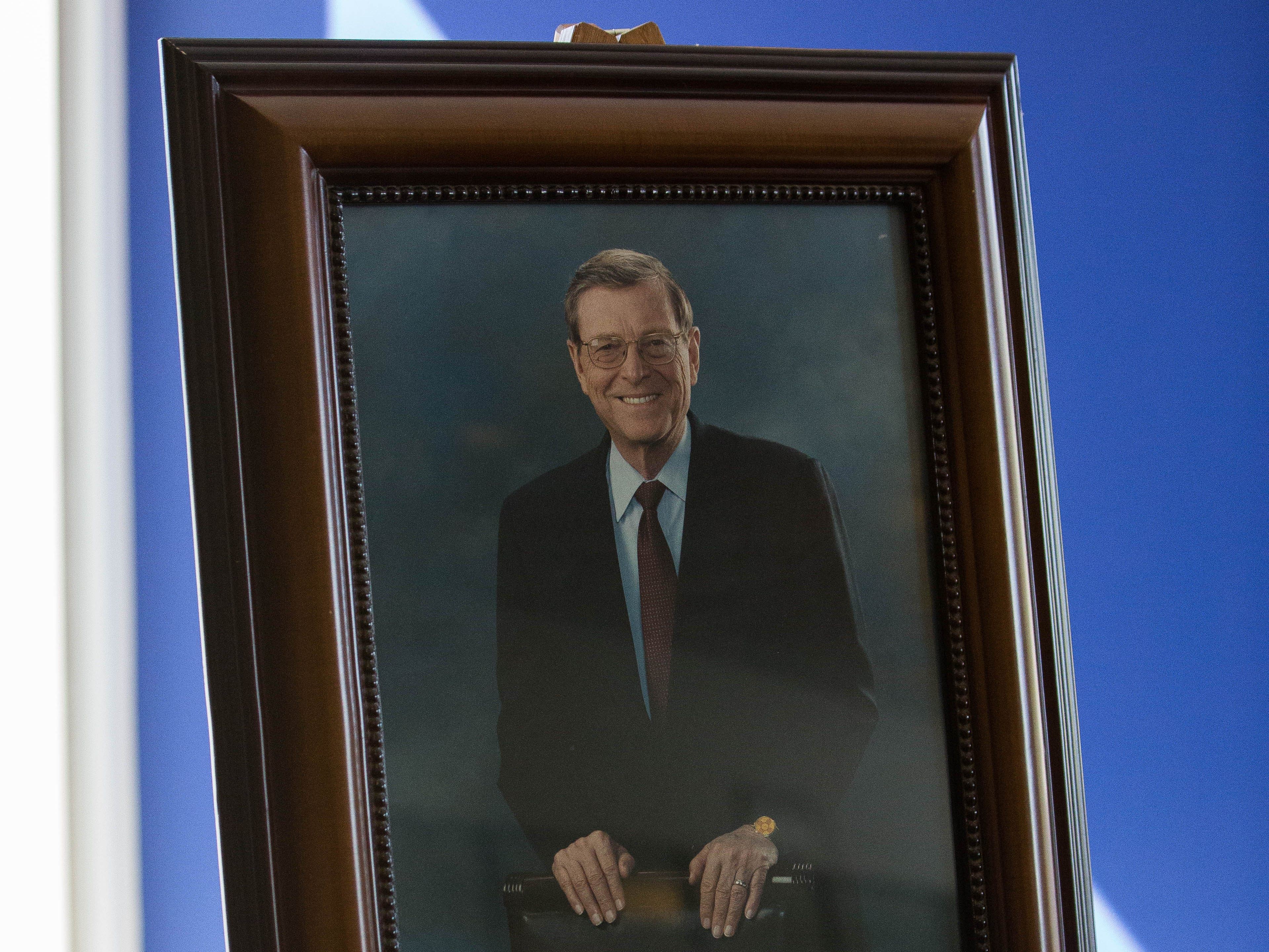 A framed portrait of Pete Domenici, former Senator from New Mexico, welcomes attendees to the 2018 Domenici Public Policy Conference, Wednesday, Sept. 12, 2018 at the Las Cruces Convention Center.
