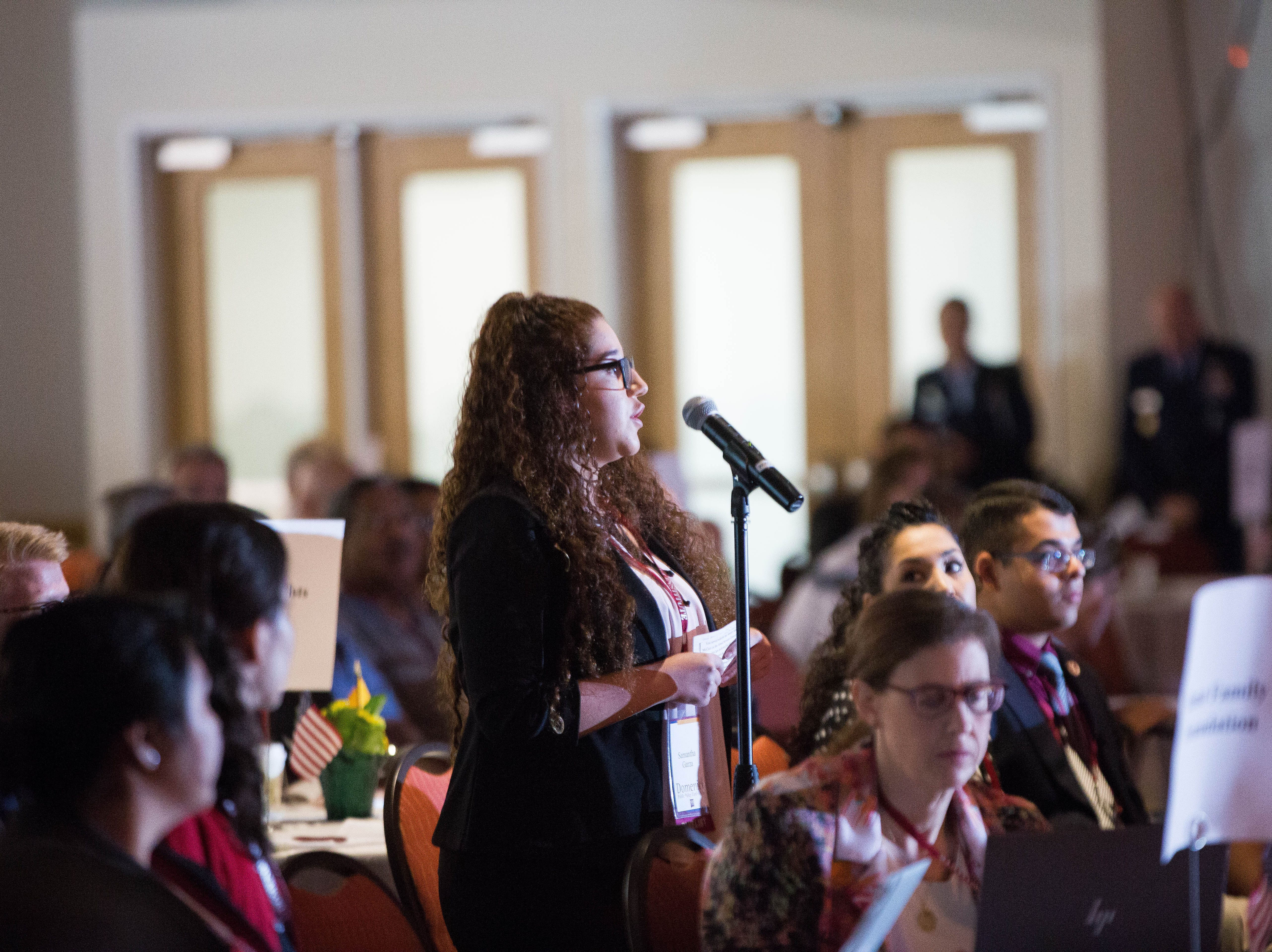 Samantha Garza, a student from New Mexico State University, asks a question to Sam Nunn, a former senator from Georgia, during the 2018 Domenici Public Policy Conference, Wednesday Sept. 12, 2018.