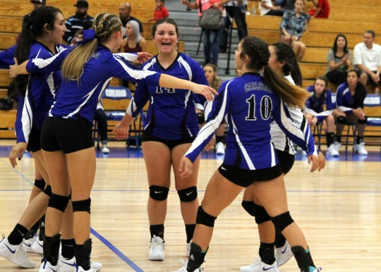 Carlsbad celebrates winning a point in the first set of Tuesday's match against Gadsden.