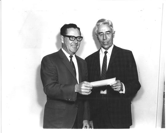 Rotary President Dr. E.Z.Robinson presents a $235 check to Oscar Dowling (68) for Carlsbad Industrial Action circa 1968.