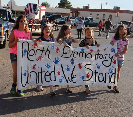 Students from North Elementary march in the Alamogordo 9/11 Memorial Parade Tuesday evening.