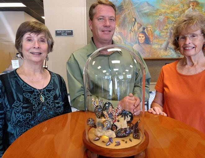 Artist JD Anderson (center) presents the Meliora sculpture to Flickinger Guild President Lee Selden (left) and Silent Auction organizer Janet Cooper (right).