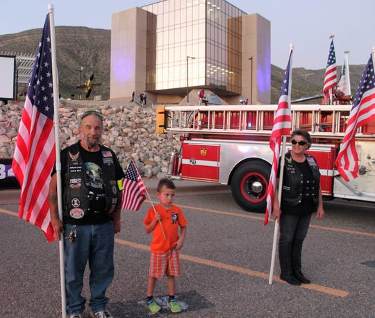 Freedom Riders hold flags before the 9/11 Memorial Ceremony began Tuesday night.
